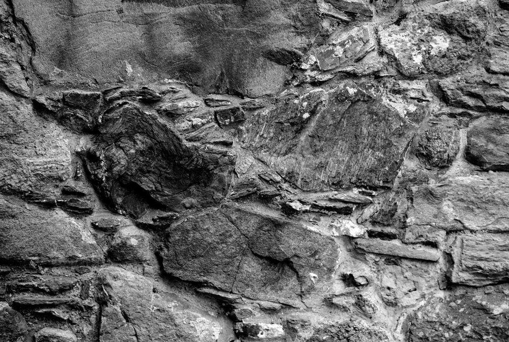Additional image, no. 4: photo of mediveal stone wall, where Håkonshallen stands today, Bergen.   Analogue 4x5, b/w photograph.