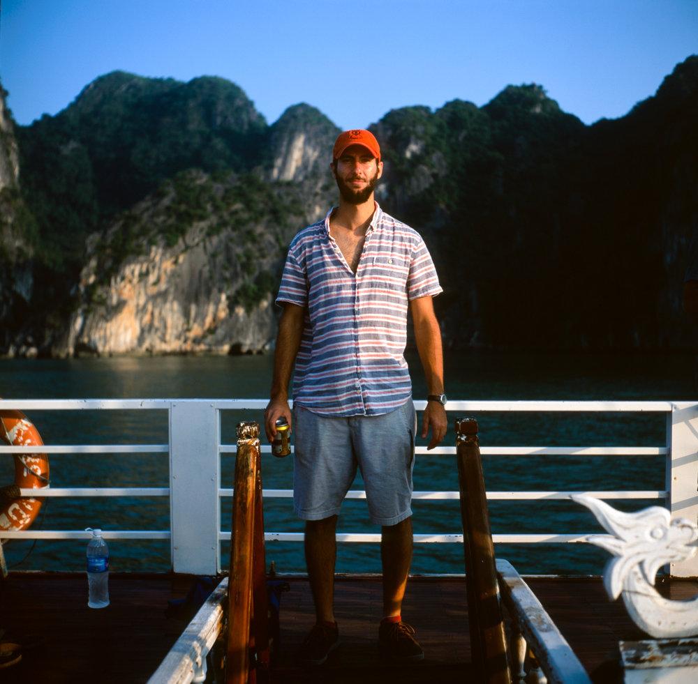 Drew on a tourist boat in Ha Long Bay.