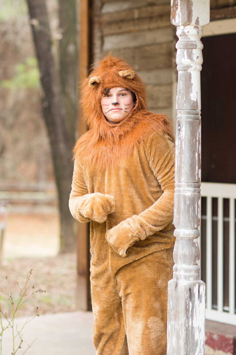 Cole Larsen as the Cowardly Lion