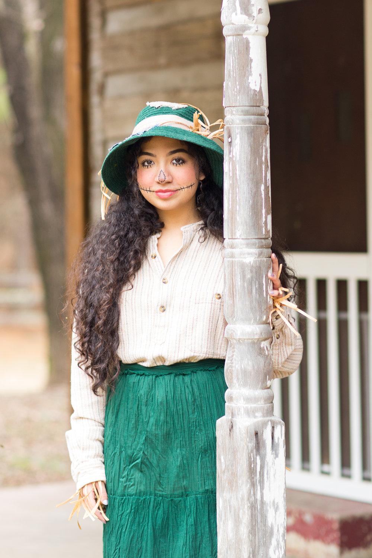 Emily Garcia as the Scarecrow