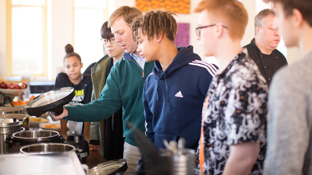 customImage  Mr. Hale examines chili peppers with students during WWOWW course.