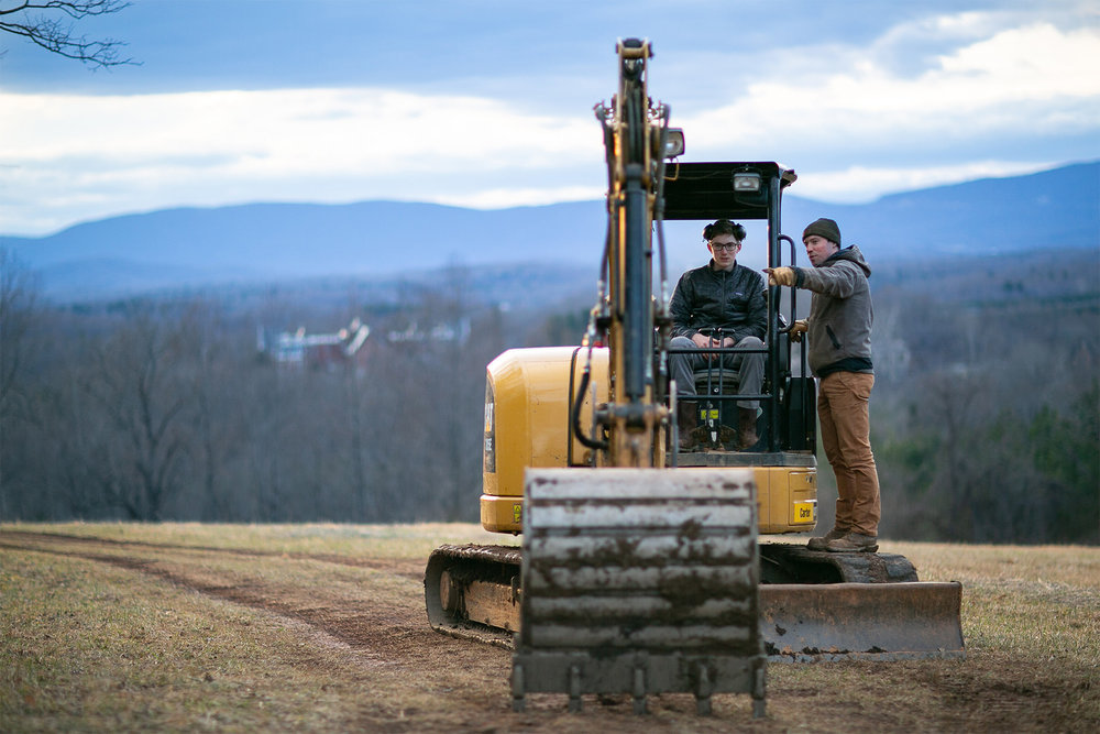 customImage  Jay Drake and his teacher Andy Guptill strategize on their project in MSA's upper meadow on a Caterpillar excavator provided by Contour Construction.