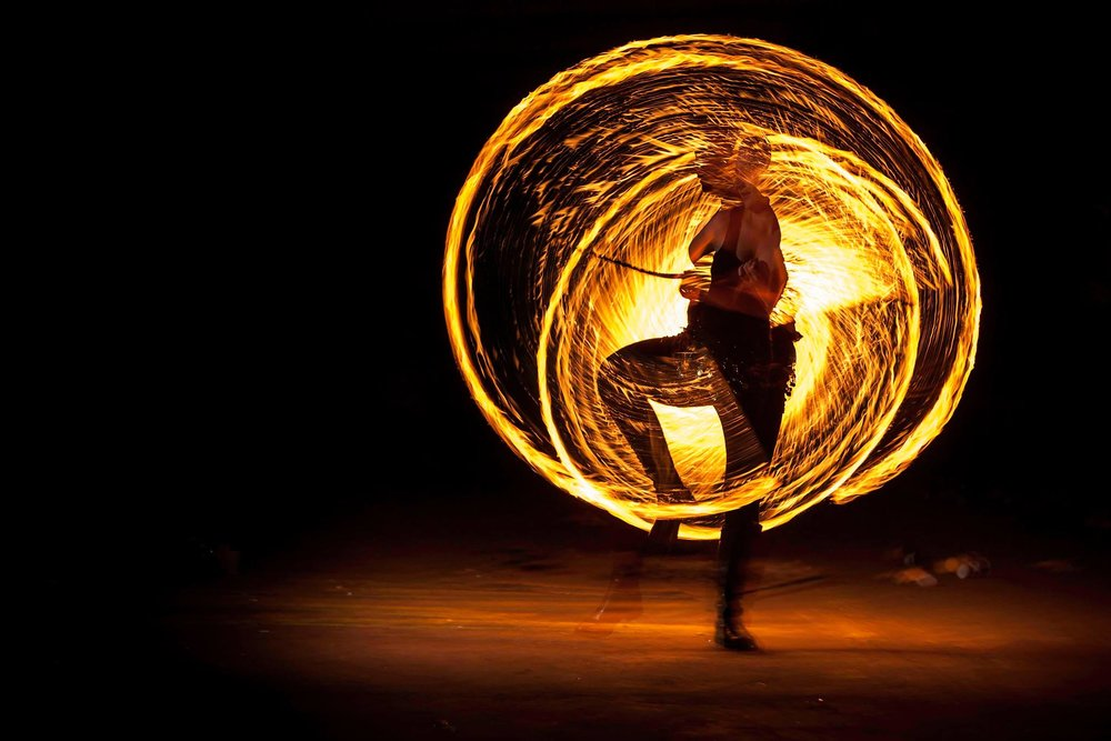 RIDDLESPARKS - Dancing with fire is like taming a dangerous element. The dancer is trying to tear through the ambient music, and the poi, fans or staff becomes an extension of his or her hands, as they slash through the darkness. This is an alternative form of dance, allowing for rhythmic dances characterized by an unprecedented visual style. In addition, the fire adds an element of tension, as it teases the crowd's primal instincts, although we always make sure that both dancers and spectators are perfectly safe.