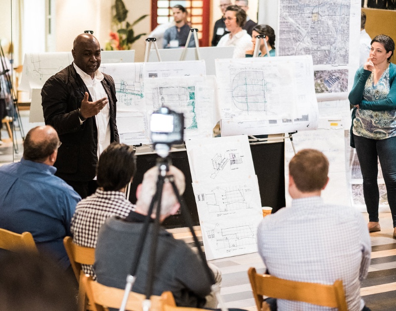 This is a group critique where the architects and planners share their initial ideas at a recent charrette for an existing urban development.