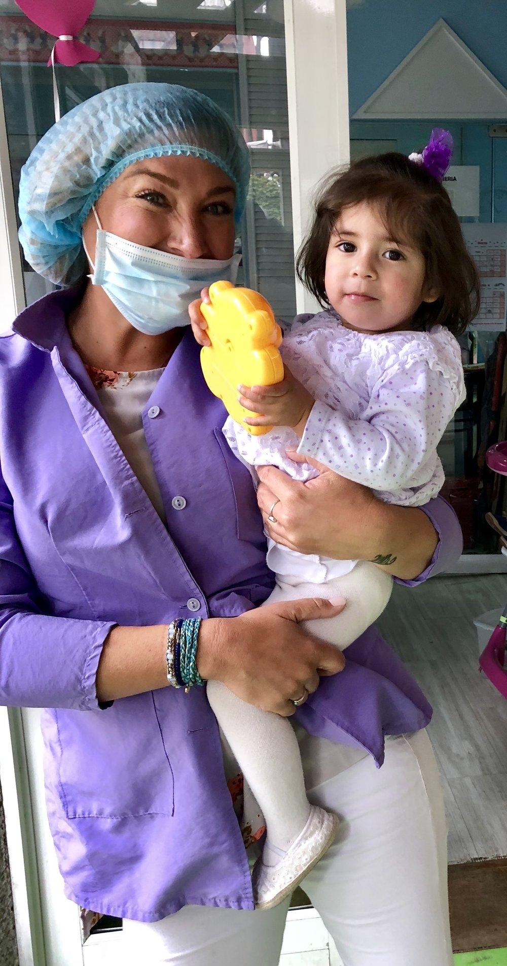 holding little girl.JPG