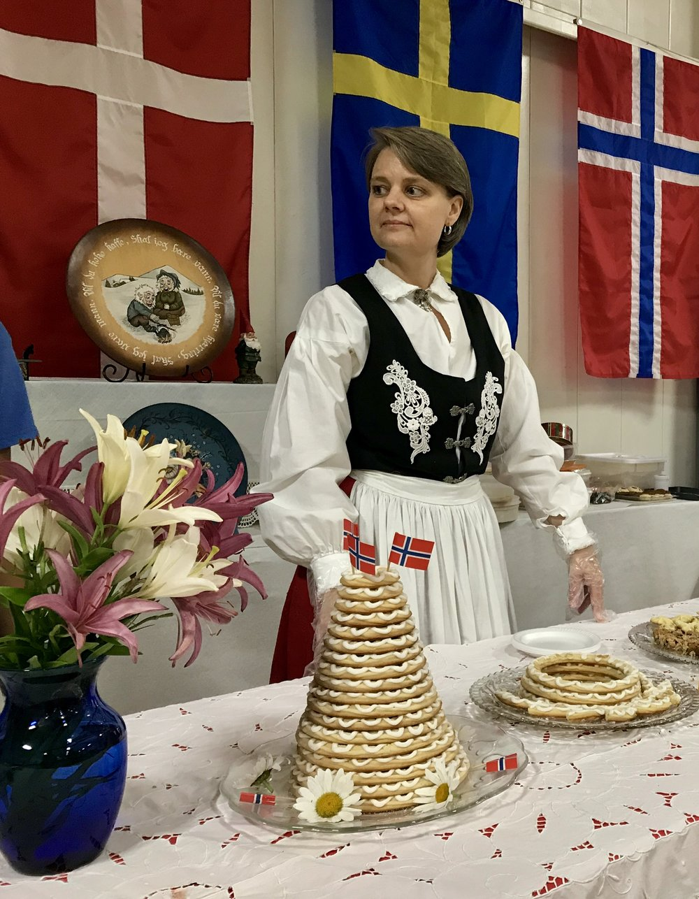 Toni Ronning stands behind her homemade Kransekake, a Norwegian wedding cake, at the Washington Island Women's Club annual International Food Festival on Friday, July 27. Ronning makes the cakes with her mother, Jeannine. The event was held in the Community Center Gym.