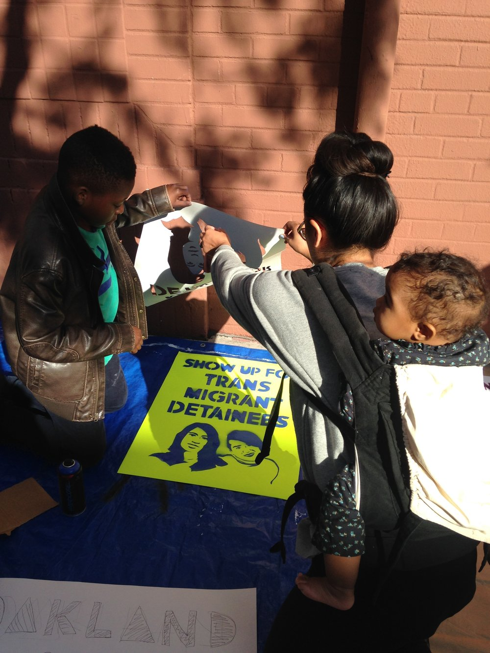 Community members in the Fruitvale district of Oakland creating art in October 2015 for the launch of  Until We Are All Free