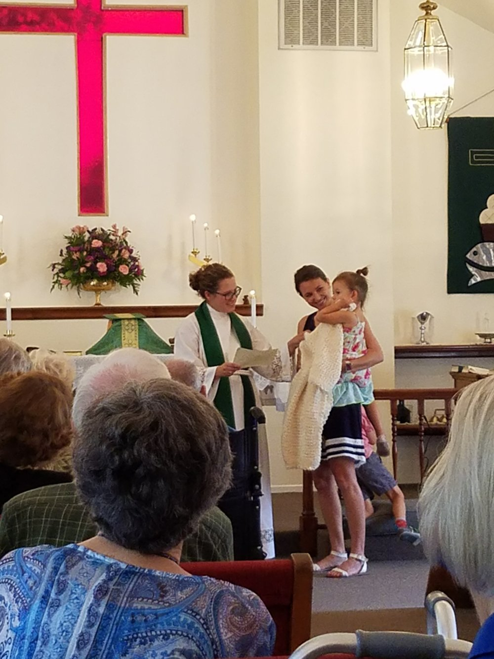 Eloise receiving her prayer shawl - One of our youngest members receives a prayer shawl for her baptism