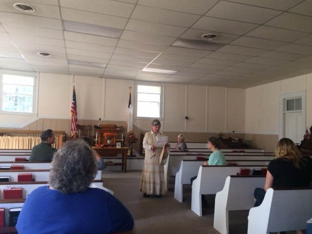 Linda Griffin explains the history of the Windham Friends Meeting House.