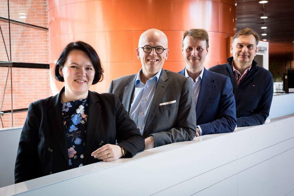 FCAI Impact Advisory Board members Ilona Lundrsröm, Risto Siilasmaa, and Ilkka Kivimäki together with the chairman of the board, Antti Vasara (second from the left). Photo: Matti Ahlgren / Aalto University.