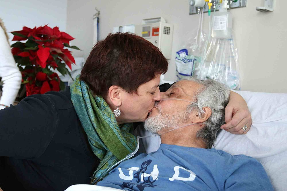 "Maurice ""Frenchie"" La-Garde kisses his wife, Heike Petermann, at the Whittier Rehabilitation Hospital in Haverhill on Thursday. La-Garde, a quadriplegic since 1987, has overcome a lot in his 61 years, and his family is asking the community for help in making it over one more hurdle: getting back home to North Chelmsford. See video at lowellsun.com. (SUN / JOHN LOVE)  Read more:  http://www.lowellsun.com/breakingnews/ci_31514501/no-mountain-too-high#ixzz50tZwThMI"