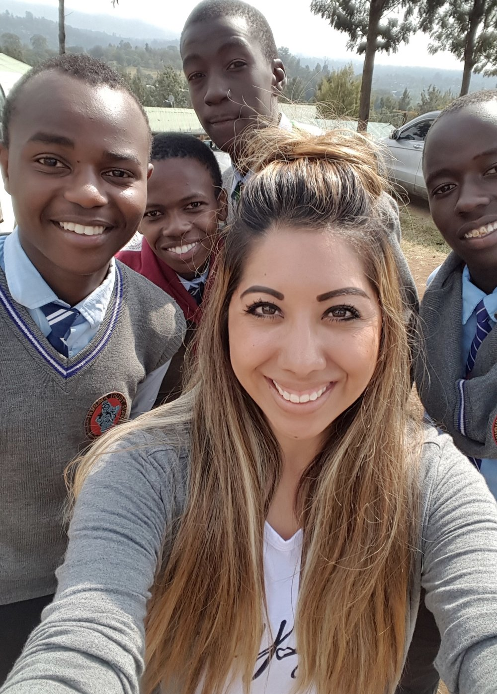 Seren Maro, board member, along with some of Huruma's high school boys.