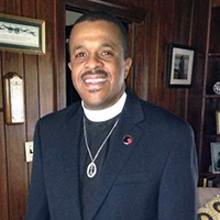 The Rev. Dr. John Myers - Minister for Justice & Minister for Church Affairs, EVA