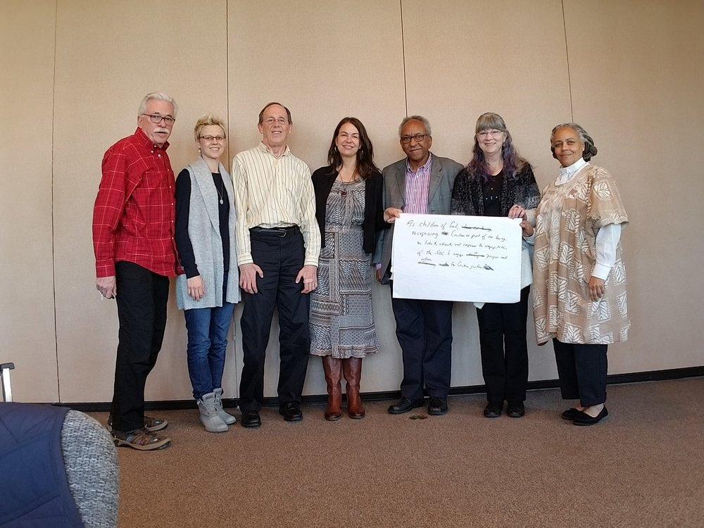 CREATION JUSTICE NETWORK    The CJN Working Group with Our New Mission Statement   Phill Wilson, Jenny Shultz-Thomas, Gary Smith, Karen Richardson Dunn, Ervin Milton, Kathy Shea, and Rev. Dele.  (Not pictured: Craig Schaub, Kaye Crawford, Cynthia Drew, Steve Halsted)