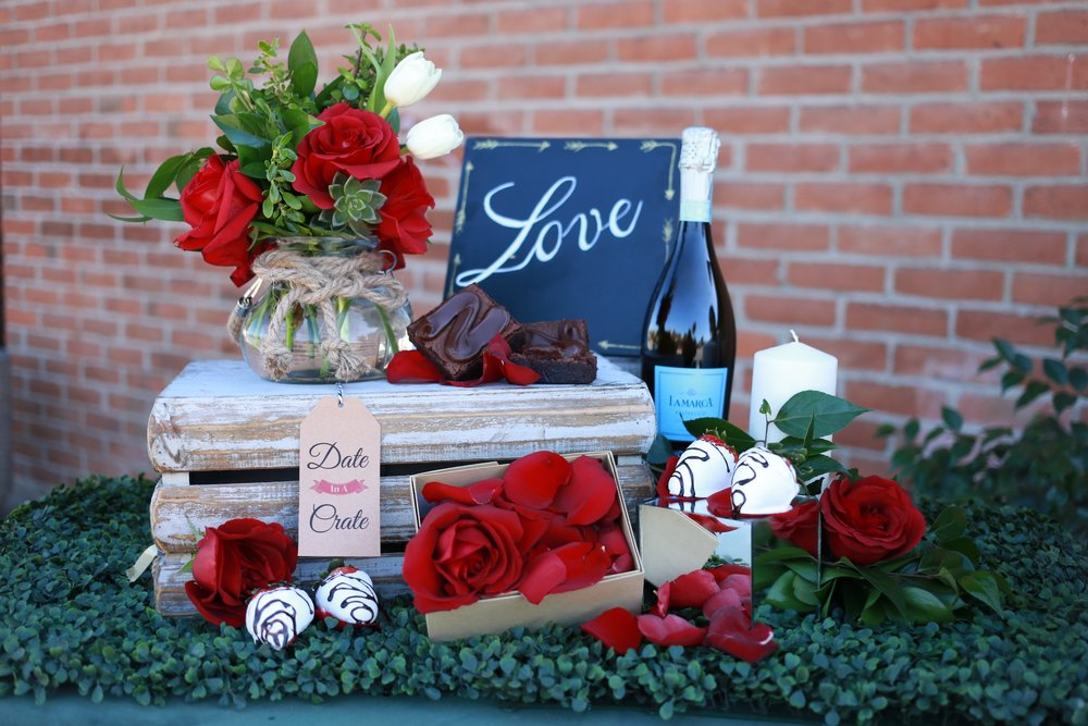 Includes; Fresh professionally arranged flowers, vase, and rose petal box by TRENDEE, chocolate covered strawberries (set of 4), triple chocolate brownies (set of 4), a romantic candle and bow, La Marca sparkling white wine, and crate to hide your special treats on your adventure.