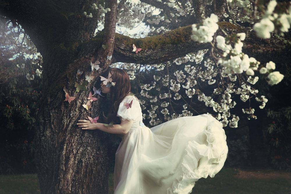psyche_white_flowing_dress_butterflies_flowers.jpg