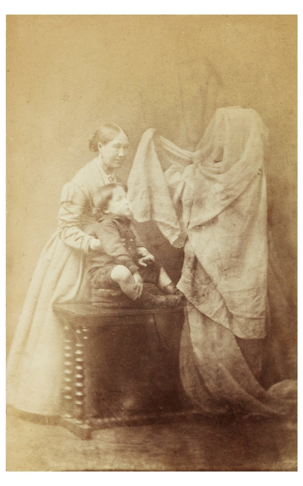 Spirit photograph by Frederick Hudson (c.1872) depicting Georgiana Houghton, child and spirit. Credit: College of Psychic Studies. Originally found here.