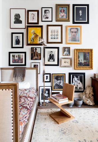 Marcus Teo's Townhouse gallery wall brings together different styles of art through a theme: Portraiture. Frames and artistic styles are different, but pieces are linked through their subject matter.     Photo by Marta Perez for The Maryn