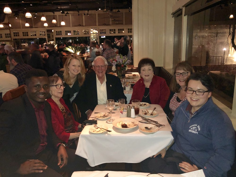 Celebrating Spencer's 40th anniversary: Spencer alumni Paulus Ackah (far left), Julia Hellman (third on left) and Sunmi Hirata (far right) talk with Charlotte Spencer, Jim Newton, Judy Newton and Libby Swinson at a reception the night before the luncheon.