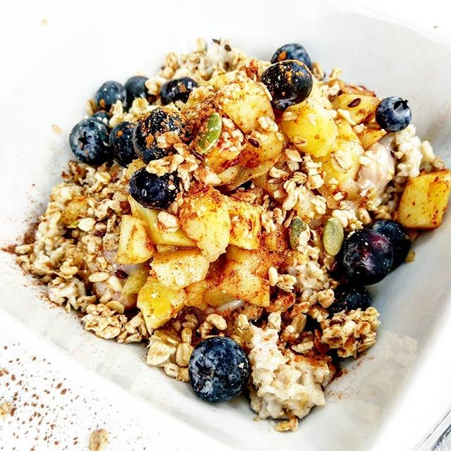 """""""Toasted Apple Crumble"""" for breakfast....or lunch, dinner, and dessert😋 . This recipe is quick, simple, AND healthy. +BONUS POINTS because it could totally double as the perfect Thanksgiving Dessert if you layer it up and bake in the oven for 15mins! #yum . Im not giving yall exact measurements because...i dont measure🤔🤷 So cook some rolled oats on the stove top. While those are simmering, chop up some skinned apples and add to a sautee pan on low heat with just a bit of coconut oil. Once they begin to soften, add some cinnamon + nutmeg. (((just a dash on the nugmeg))) Stir for a moment, turn off heat. Apples should only take 5mins or less to soften. . Turn off your oatmeal, transfer to bowl(s). . Grab some @so_delicious vanilla yogurt and mix it up with a dollop of peanut butter. Scoop this onto your oatmeal. . Add your apples over the yogurt. . Now top that deliciousness off with a generous sprinkle of crunchy @naturespathorganic granola, + blueberries. . Drizzle with pure Maple Syrup and a few more dashes of cinnamon! ENJOY!"""
