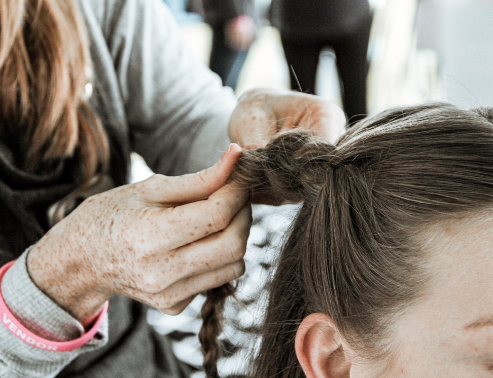 Messy braids and buns done by Browning Studio