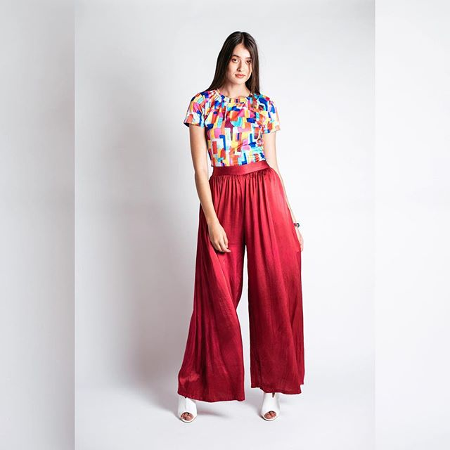 You will never know how buttery-soft the DIRONA PALAZZO PANTS are until you try them on... visit @designaspace Fitzroy to do just that! Also available online. #silkpants #palazzopants #carleyrosethelabel #redpants #silkclothing #ethicalstyle #sustainablefashion #carleyrosethelabel #wearingcarleyrose . 📸 @giuseppeinthistown 💃🏼 @rachdiaz_ 💄 @sgplove 👓 @emma_cotterill