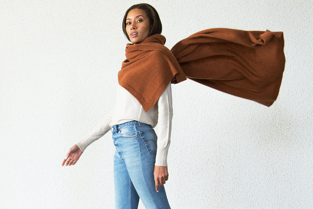 THE SIGNATURE WRAP - Our Signature cashmere wrap is a luxurious piece that you will reach for again and again. Crafted from  gorgeous Scottish cashmere and knitted into a generously proportioned  rectangle shape, its super cozy worn as a wrap or a scarf.