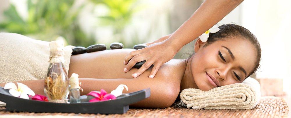 beautiful-woman-getting-spa-hot-stones-massage-in-spa-salon-l.jpg