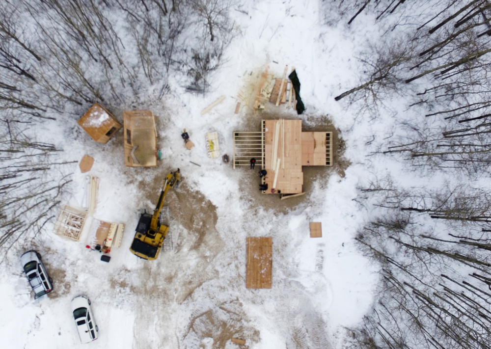 Opaskwayak Cree Nation, Umpherville Road development. In this aerial view of the lot under development, the EDITdx House is being reassembled in the upper left of the image and the floor system for the OCN trainee-designed house is under construction on the upper right.