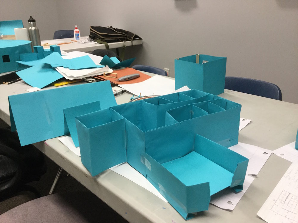 The simplicity of modeling in paper allowed trainees to rapidly convey to each other and instructor,  Chris Tallman , their ideas for a house.