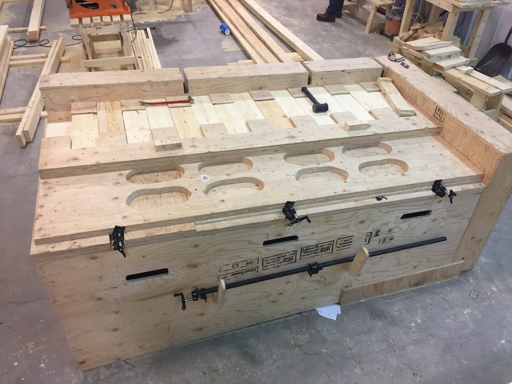 A component of the micro-CLT development was to create a system that would allow for uniform panel replication.   The work of making the jigs for panel production was led by Chris (above) while the refinement of the assembly process involved the OCN trainees (below).