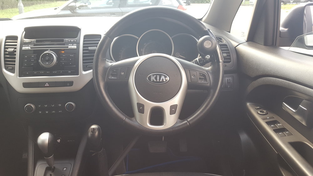 Kia Venga fiited with Carospeed Left Floor Mounted Hand Controls and Steering Ball.jpg