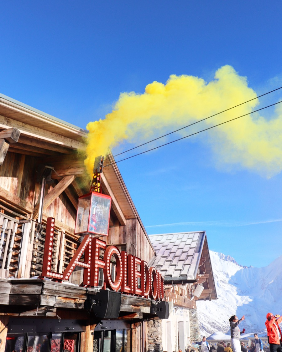 La Folie Douce St Gervais - Megeve Christmas day December 2018. Party smoke bomb against beautiful blue sky in the french alps