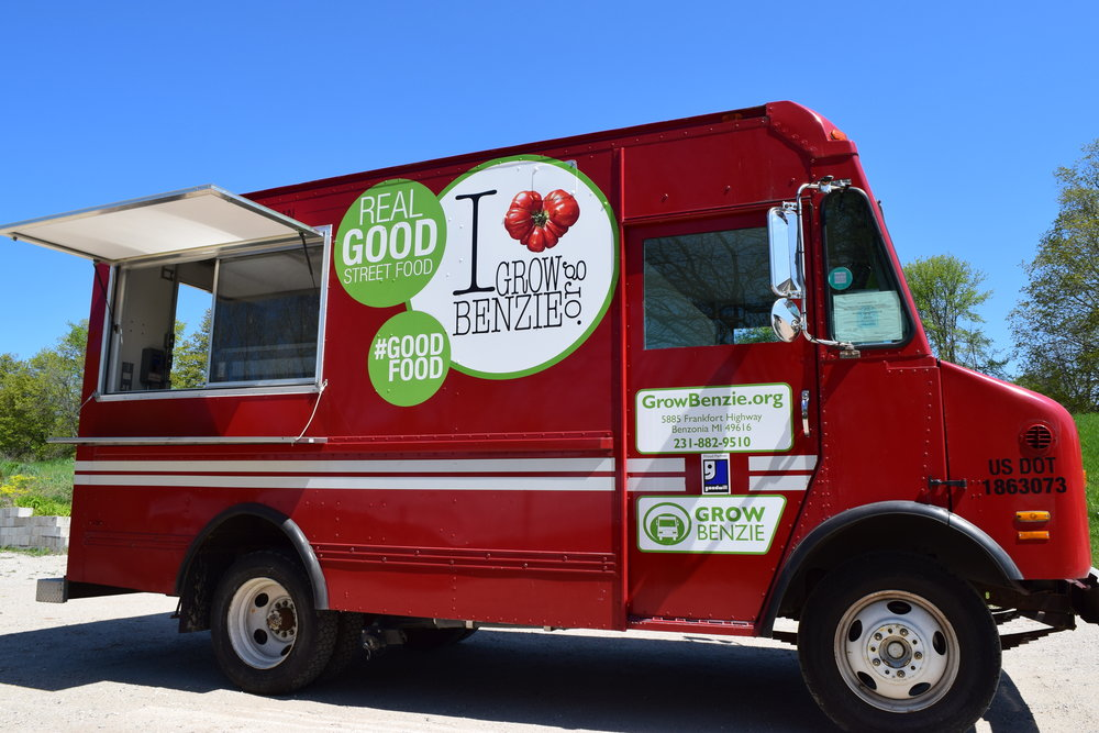 FOOD TRUCK  Understanding the growing demand for healthy eating options, alongside the risk involved with starting a food business, Grow Benzie offers a business incubator opportunity with our food truck, Grill Benzie.  We're able to support our manager with an established network of customers and venues, successful marketing, and the financial support for an entrepreneur to learn all aspects of operating a food truck. All while earning revenue that can be invested in future endeavors. Grill Benzie also focuses menu items around local ingredients that help support our local farmers and food system. Click  here  for details.