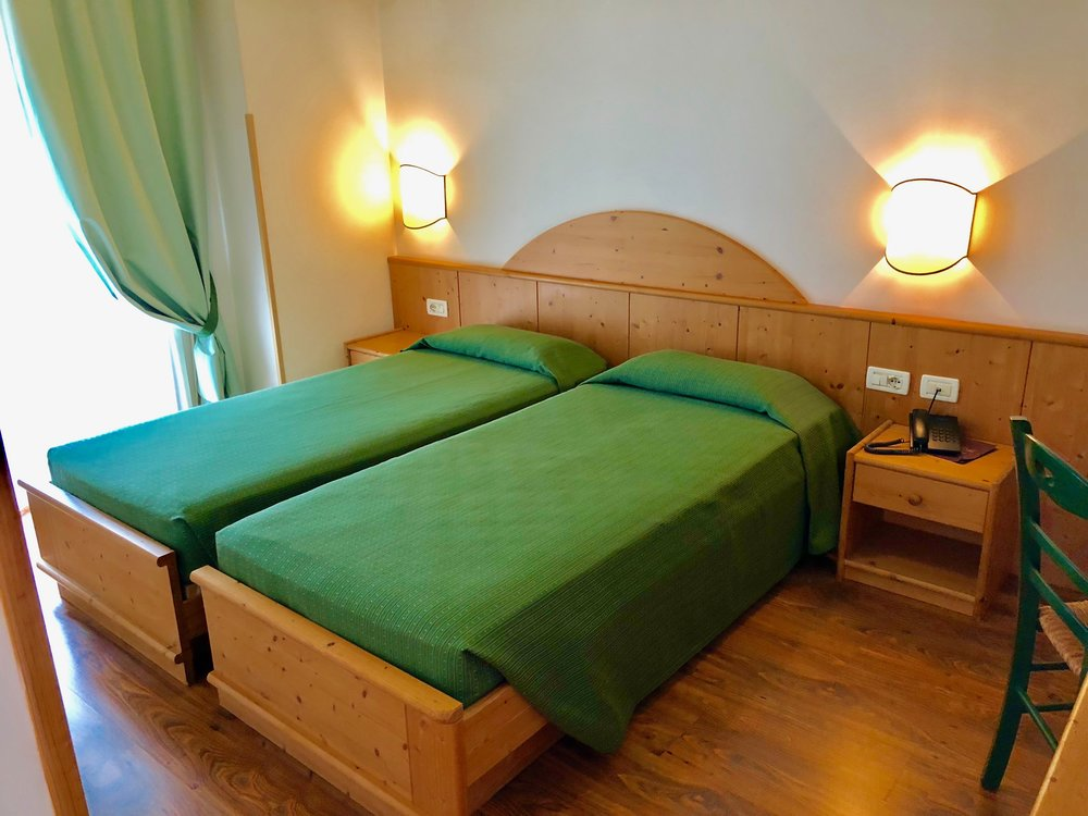 Clean, comfortable rooms at the Hotel Relais (Relax)