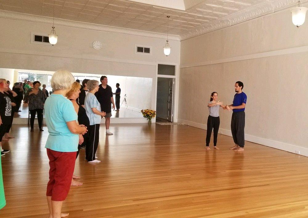 Making corrections to Yiquan Standing Meditation Postures @ Morning Glory Yoga Studio.