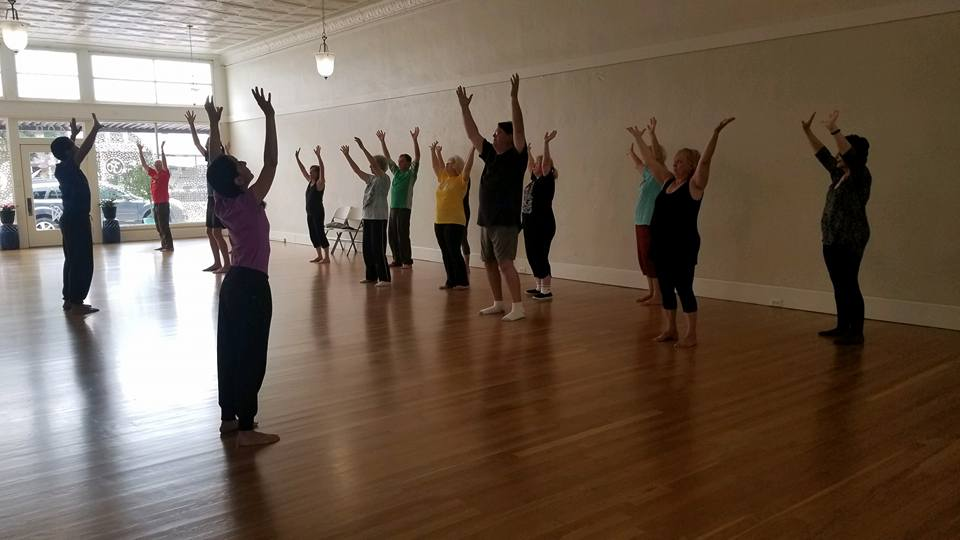 Morning exercises for strength and flexibility at Morning Glory Yoga Studio.