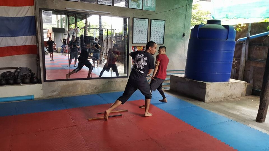 Guro Kai teaching double blade methods of Central Motion Kalis in Chiang Mai, Thailand @ Core Combat Gym with lead instructor Sakan Lam.
