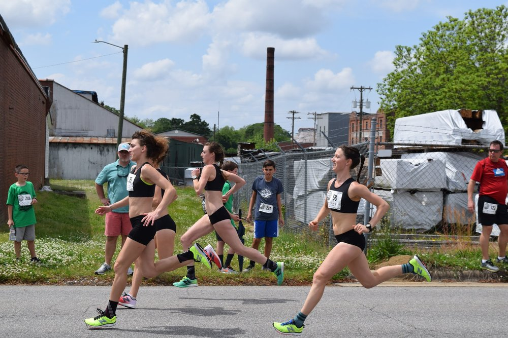 Sarah, Sammy, Rita & Erin in stride at the Rocky Mount Rocket Mile!