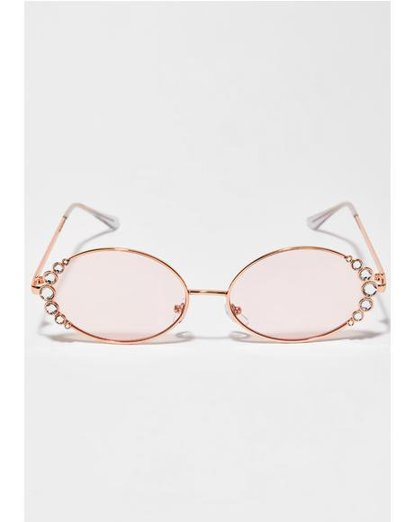 https://www.dollskill.com/festival-rhinestone-sunglasses-pink-and-rose-gold.html