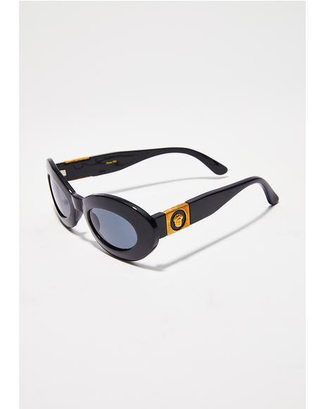 https://www.dollskill.com/gold-detail-oval-sunglasses-black.html
