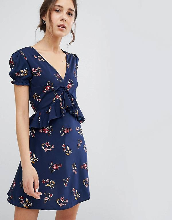 http://www.asos.com/influence/influence-frill-detail-tea-dress-with-puff-sleeve-in-floral-print/prd/9080734?clr=navy&SearchQuery=&cid=27399&gridcolumn=4&gridrow=1&gridsize=4&pge=4&pgesize=72&totalstyles=7684