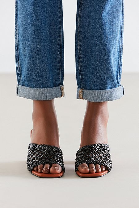 https://www.urbanoutfitters.com/shop/intentionally-blank-roll-woven-mule-heel?category=SEARCHRESULTS&color=001
