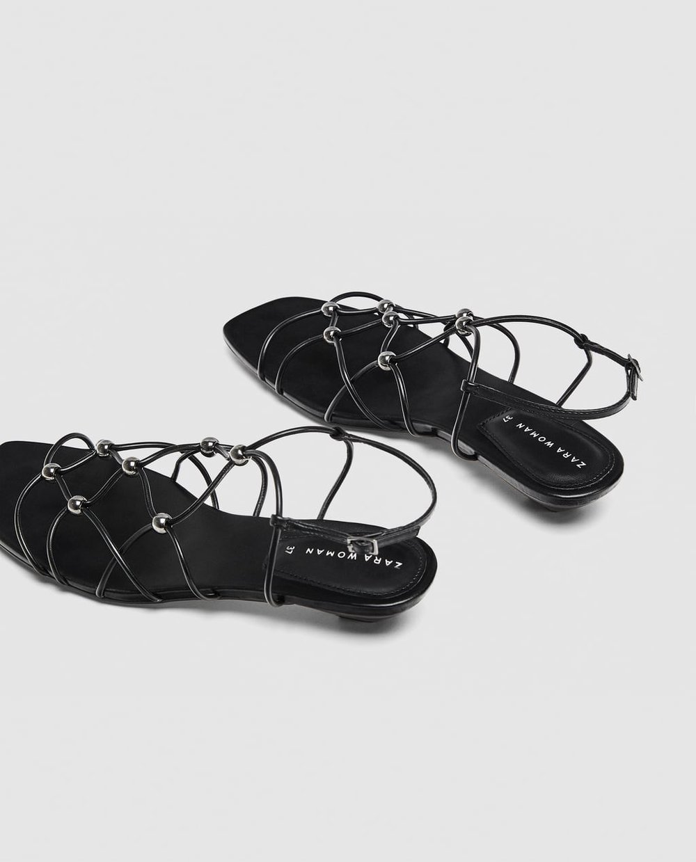 https://www.zara.com/ca/en/strappy-sandals-with-metallic-details-p15605301.html?v1=6693506&v2=969020
