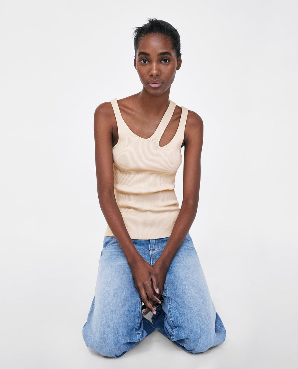 https://www.zara.com/ca/en/minimal-collection-top-with-cut-out-detail-p00014010.html?v1=5927070&v2=968893