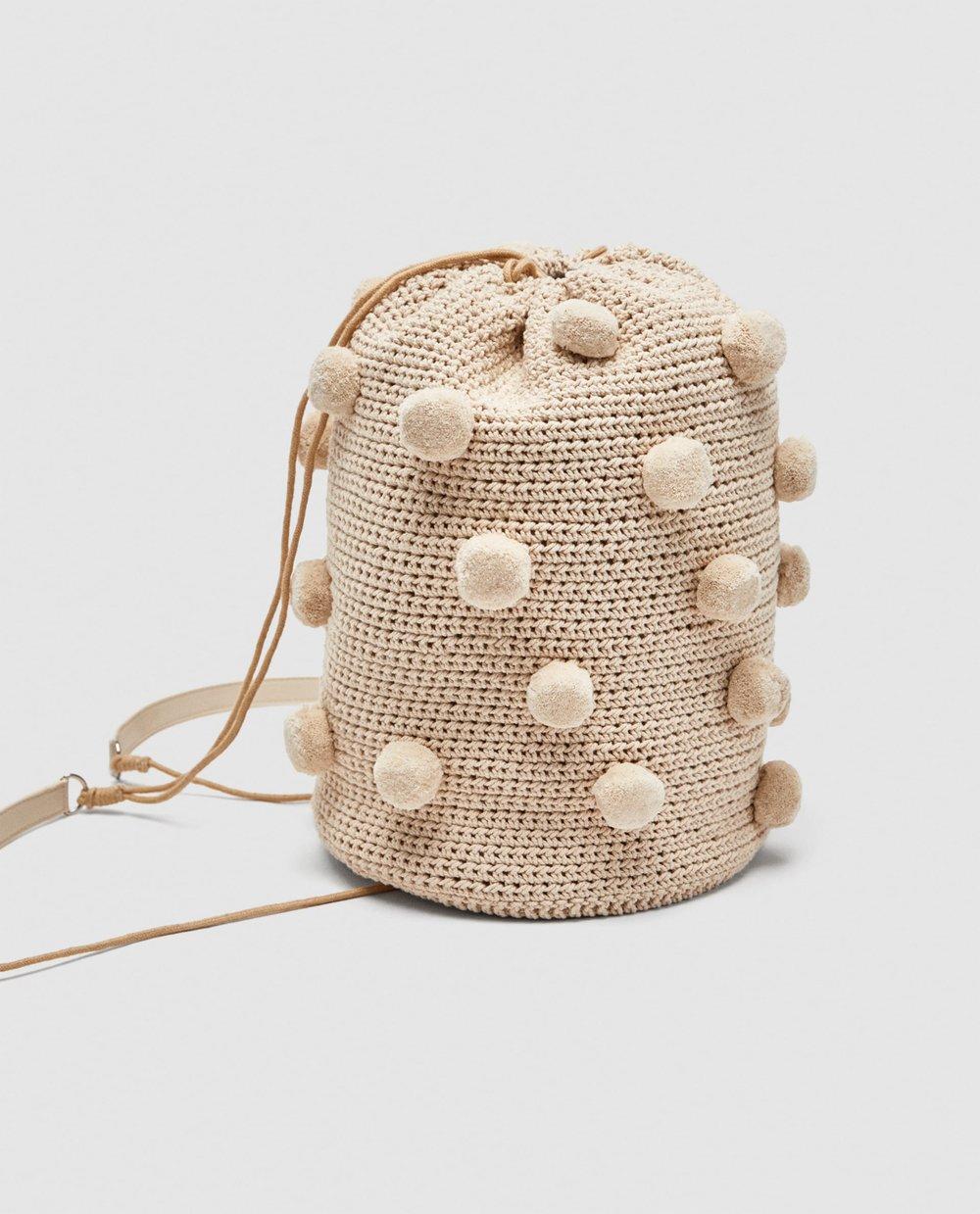 https://www.zara.com/ca/en/fabric-backpack-with-pompoms-p12056304.html?v1=5321666&v2=968875
