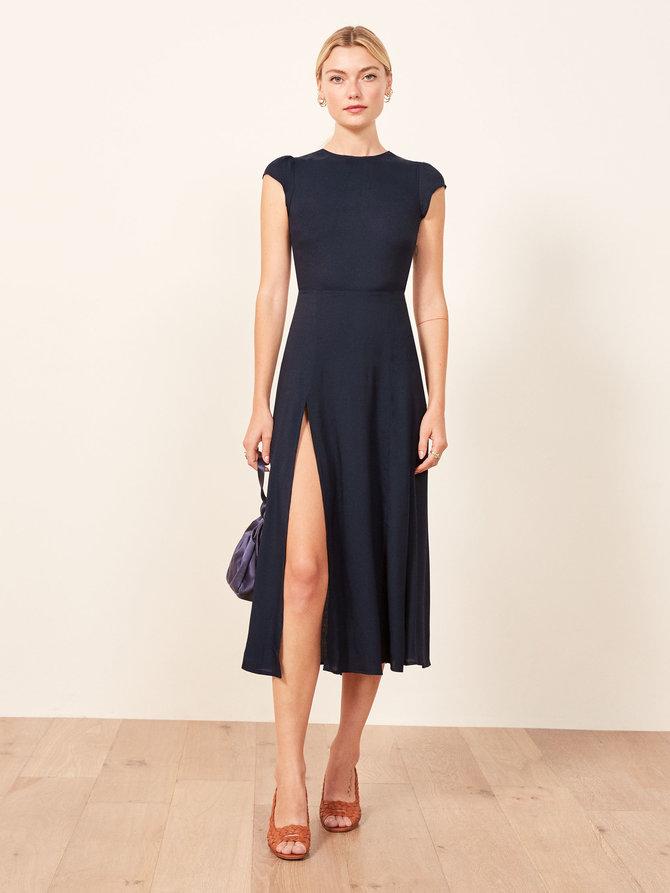 https://www.thereformation.com/products/gavin-dress?color=Navy&via=Z2lkOi8vcmVmb3JtYXRpb24td2VibGluYy9Xb3JrYXJlYTo6Q2F0YWxvZzo6Q2F0ZWdvcnkvNWE2YWRmZDJmOTJlYTExNmNmMDRlOWM2