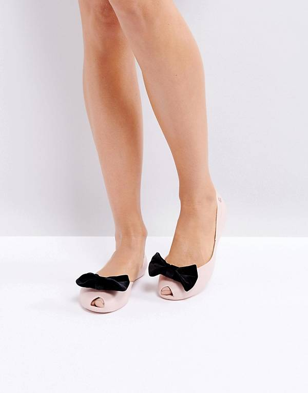 http://www.asos.com/au/vivienne-westwood-for-melissa/melissa-bow-flat-shoes/prd/8140606?clr=blushcontrast&SearchQuery=shoes%20with%20a%20bow&gridcolumn=3&gridrow=4&gridsize=4&pge=2&pgesize=72&totalstyles=121