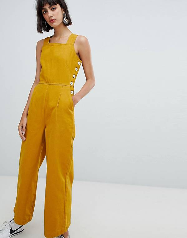 http://www.asos.com/au/asos-design/asos-design-denim-jumpsuit-with-side-buttons-in-mustard/prd/10134154?clr=mustard&SearchQuery=mustard&gridcolumn=4&gridrow=3&gridsize=4&pge=1&pgesize=72&totalstyles=134