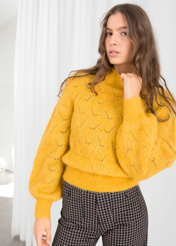 https://www.stories.com/en_usd/clothing/knitwear/sweaters/product.eyelet-knit-wool-blend-sweater-yellow.0674190001.html